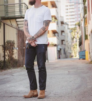 How to wear: tan suede cowboy boots, navy jeans, white crew-neck t-shirt