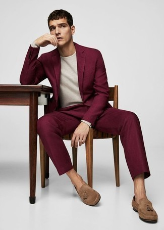 How to Wear Tan Suede Tassel Loafers: You're looking at the irrefutable proof that a purple suit and a white crew-neck sweater look awesome when combined together in a refined look for a modern gent. Complement your look with tan suede tassel loafers et voila, this outfit is complete.