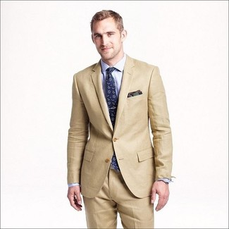 How to wear: tan suit, light blue dress shirt, navy floral tie, olive camouflage pocket square