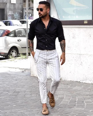 How to wear: black sunglasses, tan suede tassel loafers, white vertical striped chinos, black long sleeve shirt