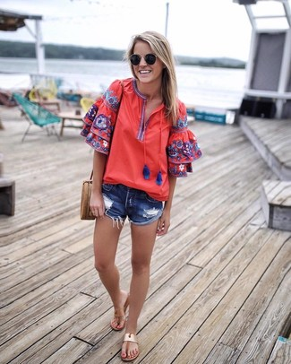 How to wear: tan leather crossbody bag, tan leather thong sandals, blue ripped denim shorts, red embroidered peasant blouse