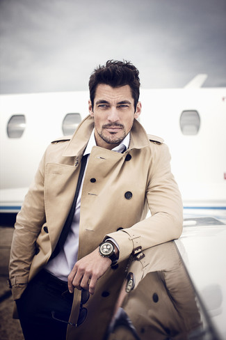 David Gandy wearing Tan Trenchcoat, Black Suit, White Dress Shirt, Black Leather Watch