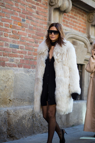 How to wear: black suede pumps, black lace tank dress, black chunky cardigan, white fur coat