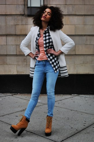 How to wear: blue skinny jeans, pink tank, white and black check dress shirt, white and black coat