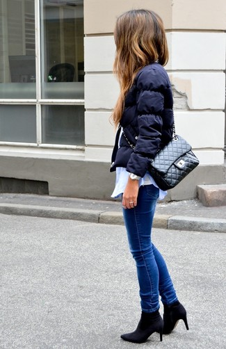 How to wear: blue skinny jeans, white tank, light blue dress shirt, navy puffer jacket