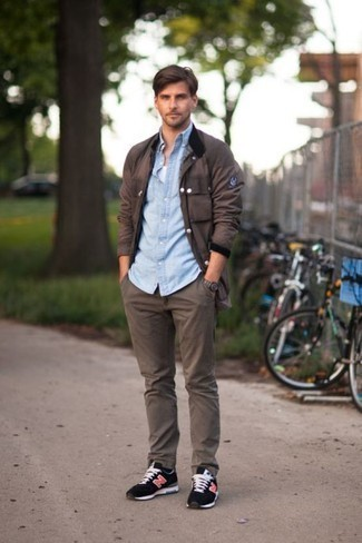 How to Wear a Light Blue Chambray Long Sleeve Shirt For Men: Parade your sartorial know-how by opting for a light blue chambray long sleeve shirt and dark brown chinos. And if you need to effortlessly tone down this look with one single piece, why not complement your ensemble with a pair of black athletic shoes?