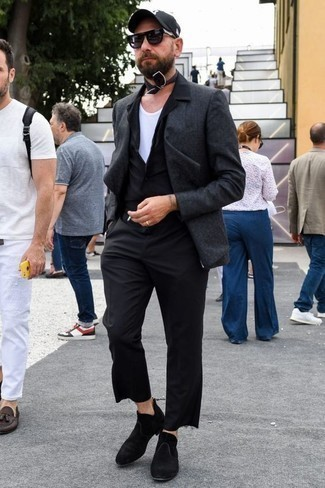 How to Wear a White Tank For Men: If you're all about relaxed dressing when it comes to fashion, you'll appreciate this relaxed combination of a white tank and black chinos. Black suede chelsea boots will bring an elegant twist to an otherwise mostly dressed-down outfit.