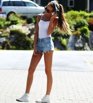 Consider pairing a white tank with baby blue distressed denim shorts for a casual coffee run. For a more relaxed take, go for a pair of white high top sneakers. So if it's a hot afternoon and you want to look cute without putting in too much work, this ensemble will do the job in next to no time.