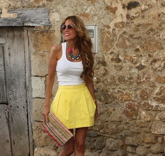 How to wear: white tank, yellow skater skirt, multi colored embroidered clutch, brown sunglasses