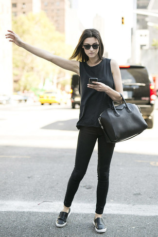 A black tank and black skinny jeans are a great outfit formula to have in your arsenal. For the maximum chicness throw in a pair of black leather slip-on sneakers.