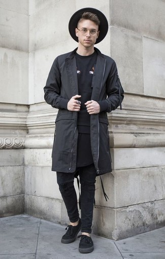 How to Wear Black Canvas Low Top Sneakers For Men: A black raincoat and black ripped jeans are wonderful menswear essentials that will integrate perfectly within your current lineup. You can take a classic approach with shoes and complement this getup with a pair of black canvas low top sneakers.
