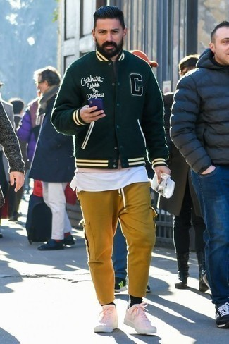 How to Wear a White Tank For Men: Try teaming a white tank with mustard cargo pants for comfort dressing with an edgy spin. You could perhaps get a little creative in the footwear department and complement this ensemble with a pair of pink leather low top sneakers.