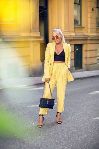 How to wear: black leather heeled sandals, yellow tapered pants, black bustier top, yellow blazer