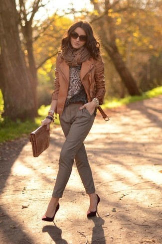 How to wear: burgundy suede pumps, brown tapered pants, brown leopard crew-neck sweater, brown leather biker jacket