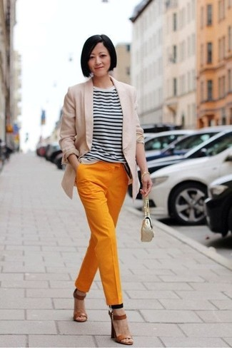 How to wear: brown leather heeled sandals, orange tapered pants, white and black horizontal striped crew-neck t-shirt, beige blazer