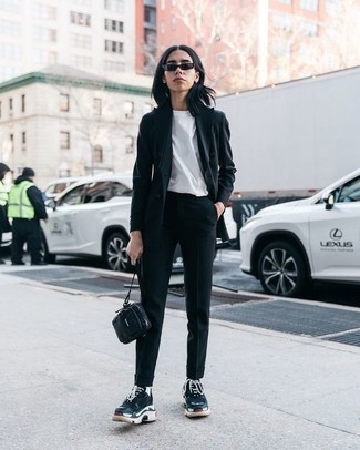 How to wear: black athletic shoes, black tapered pants, white crew-neck t-shirt, black blazer