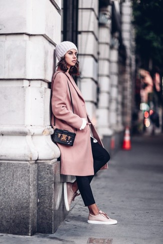 How to Wear a Pink Coat For Women: A pink coat and black tapered pants are the kind of a winning combo that you need when you have no extra time to spare. Complete your ensemble with a pair of pink leather low top sneakers to avoid looking too polished.