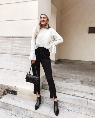How to wear: black leather ankle boots, black tapered pants, white ruffle long sleeve blouse, white cable sweater