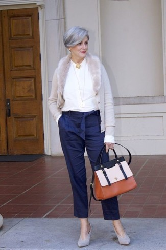 How to wear: grey suede pumps, navy vertical striped tapered pants, white long sleeve blouse, grey cardigan