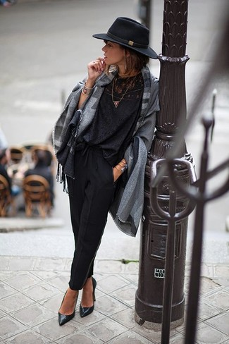 How to wear: black leather pumps, black tapered pants, black lace long sleeve blouse, grey plaid poncho