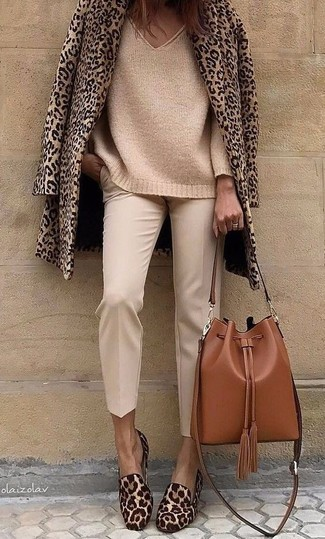 How to wear: brown leopard calf hair loafers, beige tapered pants, tan knit oversized sweater, tan leopard pea coat