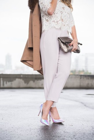 How to Wear a White and Black Lace Blouse: Rock a white and black lace blouse with grey tapered pants for a comfy outfit that's also pulled together nicely. Add a pair of silver leather pumps to the mix and ta-da: this outfit is complete.