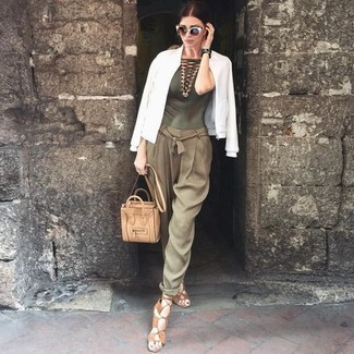 How to wear: tan leather gladiator sandals, olive tapered pants, olive crochet sleeveless top, white bomber jacket