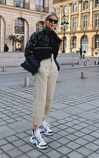 How to wear: white and black athletic shoes, beige tapered pants, black turtleneck, black puffer jacket