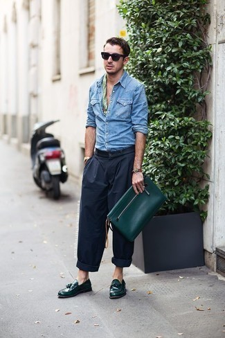 How to Wear a Light Blue Denim Shirt For Men: Effortlessly blurring the line between cool and casual, this combo of a light blue denim shirt and navy chinos will easily become one of your go-tos. Feeling adventerous? Shake things up by sporting dark green leather tassel loafers.