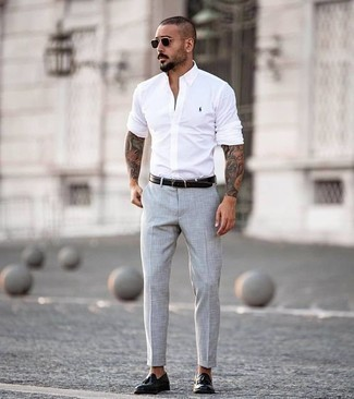 Men's Looks & Outfits: What To Wear In 2020: A white long sleeve shirt and grey chinos are a great outfit worth having in your current casual rotation. Black leather tassel loafers will breathe an extra touch of elegance into an otherwise utilitarian ensemble.