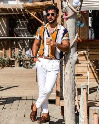How to wear: brown leather belt, brown leather tassel loafers, white chinos, multi colored vertical striped short sleeve shirt