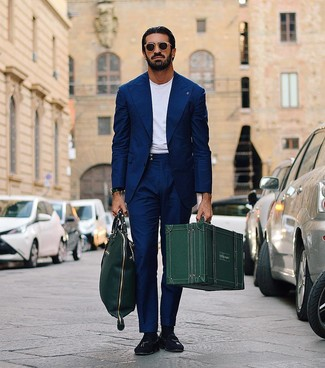 How to wear: dark green leather tote bag, black suede tassel loafers, white crew-neck t-shirt, navy suit