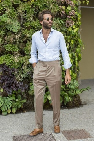 How to Wear a Silver Watch For Men: For a neat and relaxed outfit, reach for a light blue vertical striped long sleeve shirt and a silver watch — these two pieces play brilliantly together. Feeling brave today? Polish up this ensemble by rocking a pair of tan leather tassel loafers.
