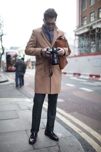 How to Wear a Brown Leather Briefcase: This combo of a camel overcoat and a brown leather briefcase spells comfort and casual cool. And it's a wonder how dark purple leather tassel loafers can class up an ensemble.
