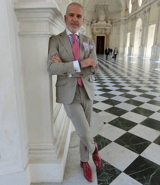 How to wear: pink tie, red leather tassel loafers, light blue dress shirt, grey suit
