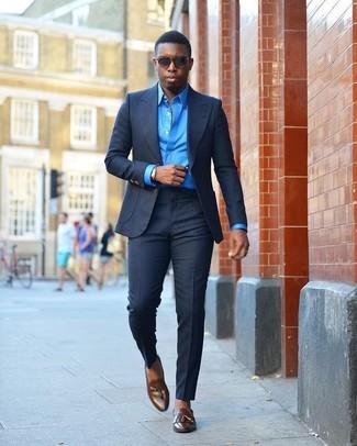How to wear: dark brown sunglasses, dark brown leather tassel loafers, blue dress shirt, navy suit