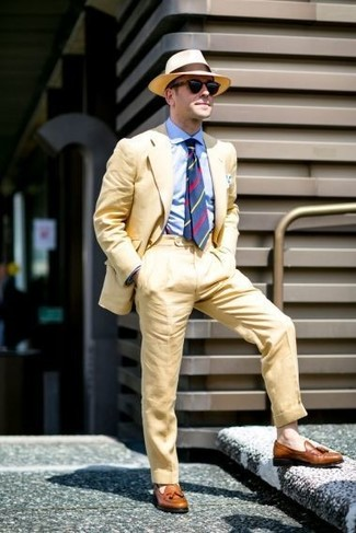 How to wear: tan straw hat, brown leather tassel loafers, light blue dress shirt, yellow suit