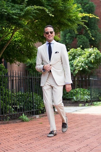 How to wear: navy knit tie, grey canvas tassel loafers, light blue dress shirt, beige seersucker suit