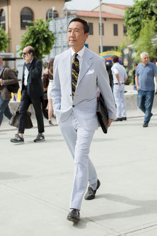 How to wear: black leather briefcase, black leather tassel loafers, white dress shirt, light blue seersucker suit