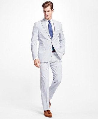 How to wear: blue polka dot tie, brown suede tassel loafers, white dress shirt, white seersucker suit
