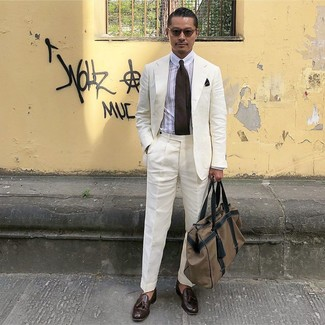 How to wear: brown canvas holdall, dark brown leather tassel loafers, white vertical striped dress shirt, white linen suit