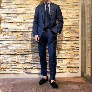 How to wear: navy silk tie, black suede tassel loafers, white and navy vertical striped dress shirt, navy suit