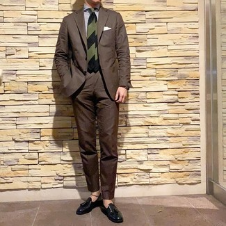 How to wear: dark green horizontal striped tie, black leather tassel loafers, white and navy vertical striped dress shirt, dark brown suit