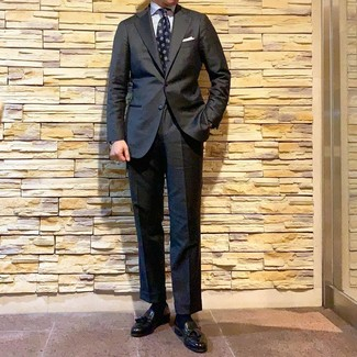 How to wear: navy print tie, black leather tassel loafers, white vertical striped dress shirt, charcoal suit