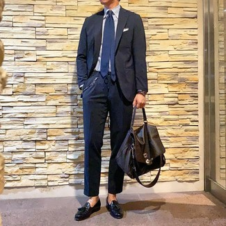 How to wear: dark brown leather briefcase, black leather tassel loafers, light blue vertical striped dress shirt, navy suit