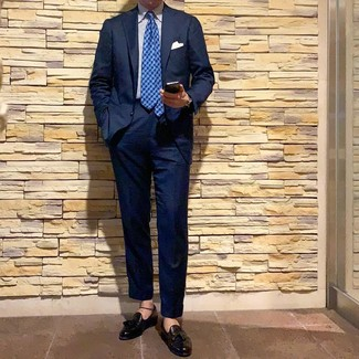 How to wear: blue houndstooth tie, black leather tassel loafers, white and blue vertical striped dress shirt, navy suit