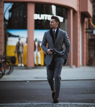 How to Wear a Navy Scarf For Men: This combination of a grey vertical striped suit and a navy scarf is clean, seriously stylish and extremely easy to replicate. Throw a pair of black suede tassel loafers in the mix for a major style upgrade.