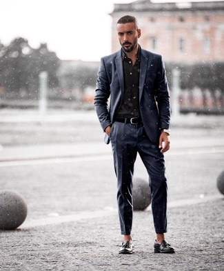 How to wear: black leather belt, black leather tassel loafers, black dress shirt, navy suit