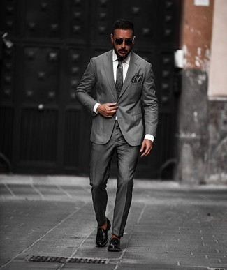 How to wear: charcoal tie, black leather tassel loafers, white dress shirt, charcoal suit