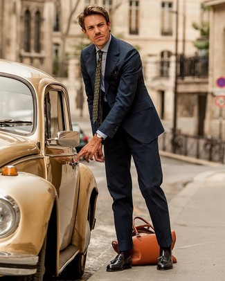 How to Wear a Navy Vertical Striped Suit: For an outfit that's classy and envy-worthy, marry a navy vertical striped suit with a light blue chambray dress shirt. All you need now is a pair of dark brown leather tassel loafers.
